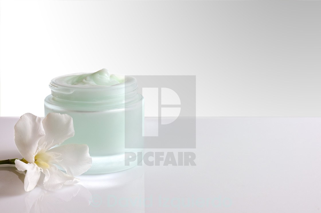 """""""Cream jar open with flower front view white isolated"""" stock image"""