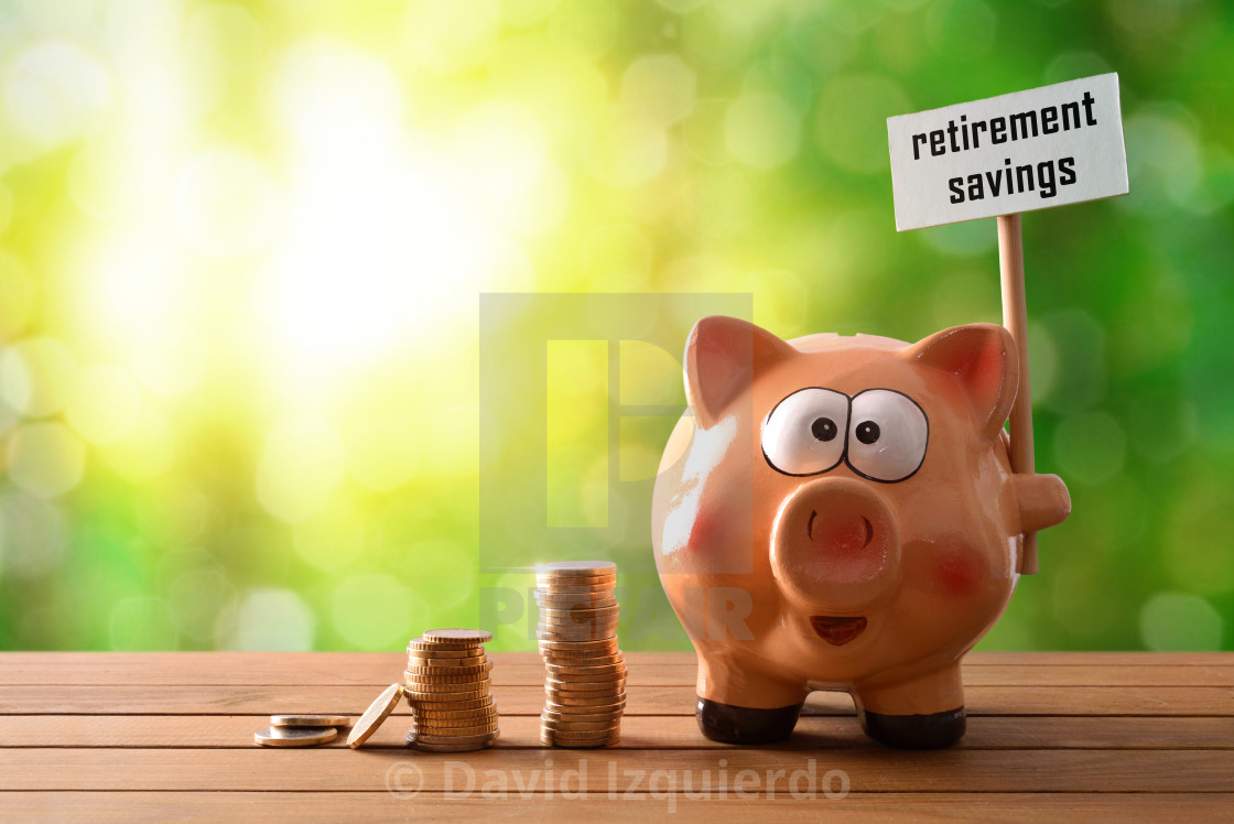 """""""Piggy bank with billboard retirement savings on table nature background"""" stock image"""