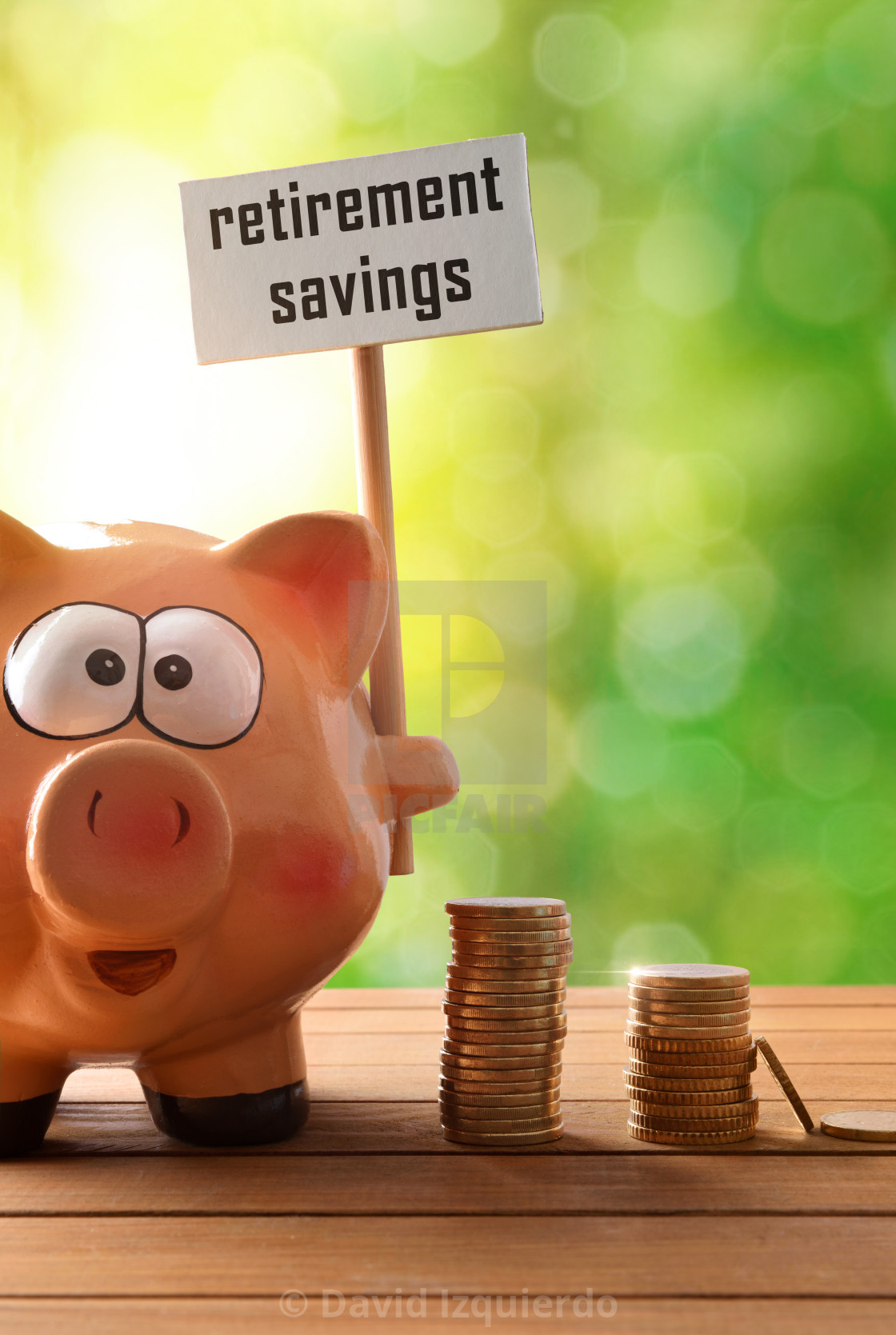"""""""Piggy bank with billboard retirement savings on table nature vertical"""" stock image"""