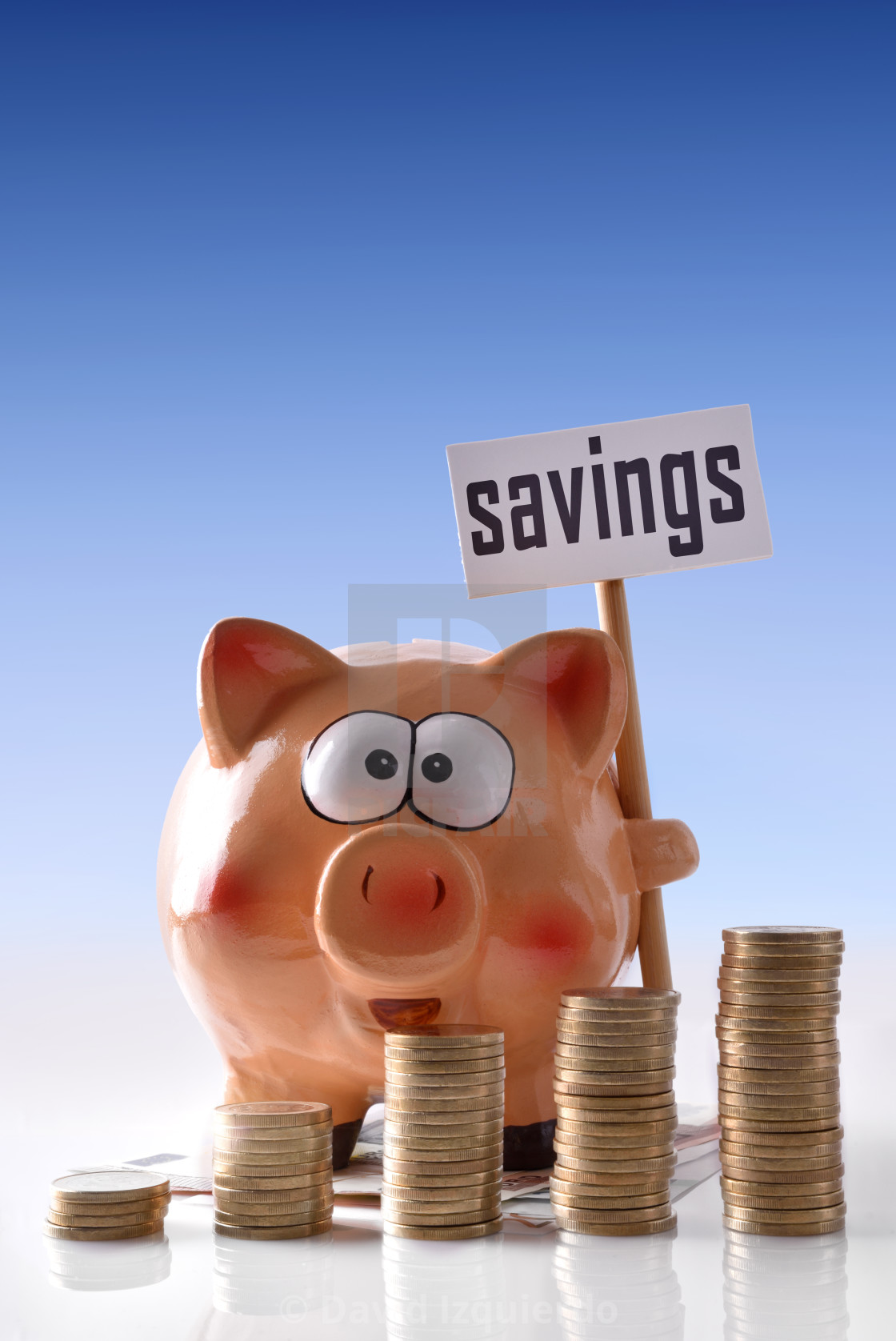 """""""Piggy bank with savings billboard and coins blue background vertical"""" stock image"""