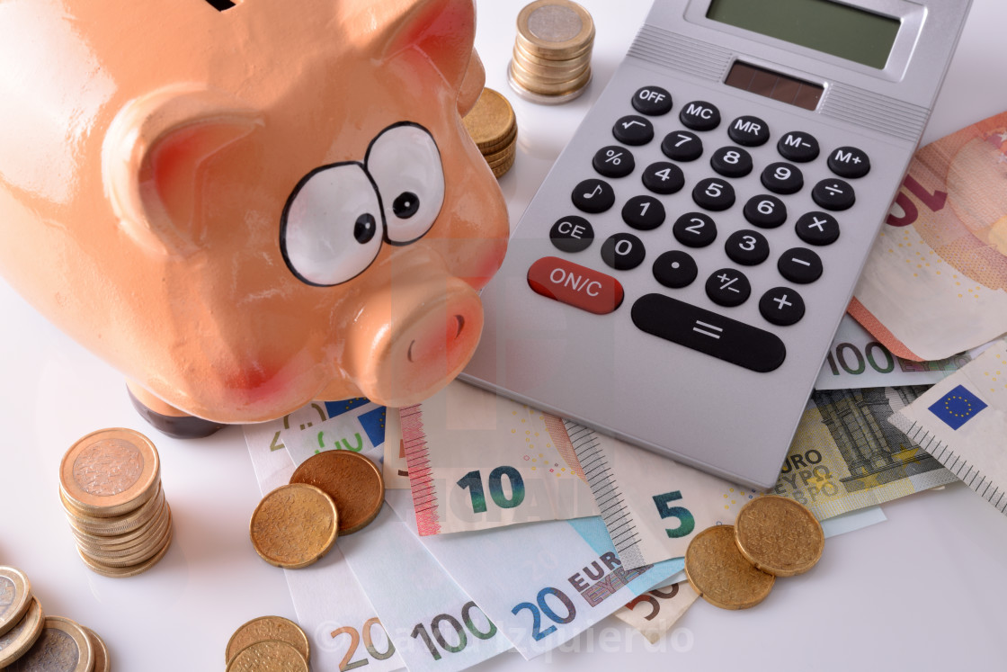 """""""Savings and accounting with piggy bank money and calculator elevated"""" stock image"""