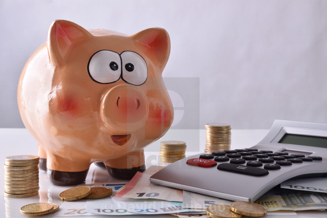 """Savings and accounting with piggy bank money and calculator front"" stock image"