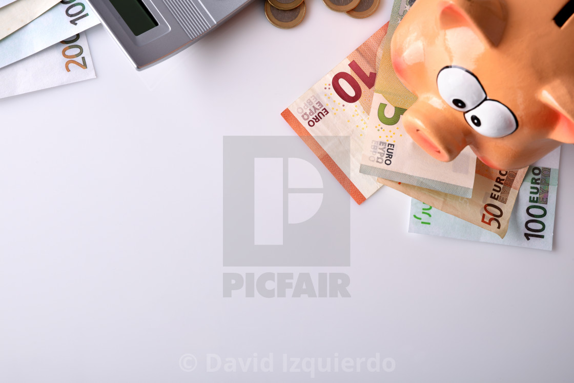 """Savings with piggy bank and money and calculator top"" stock image"