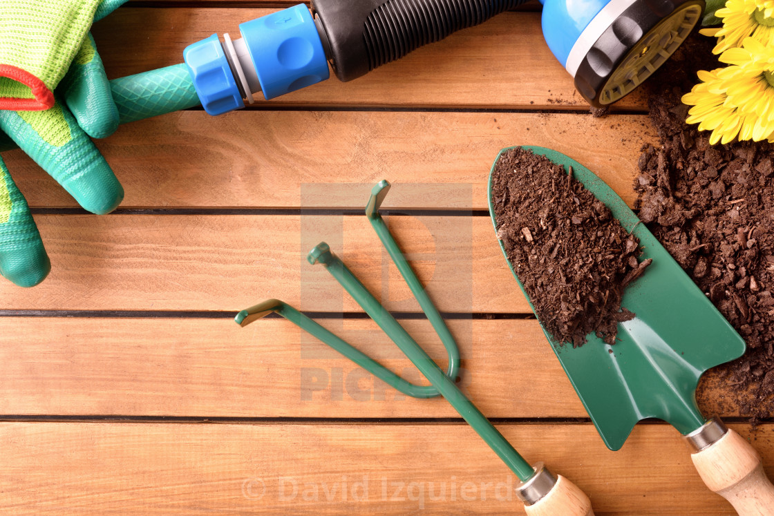 Garden Tools Set On A Wooden Table Top View License Download Or