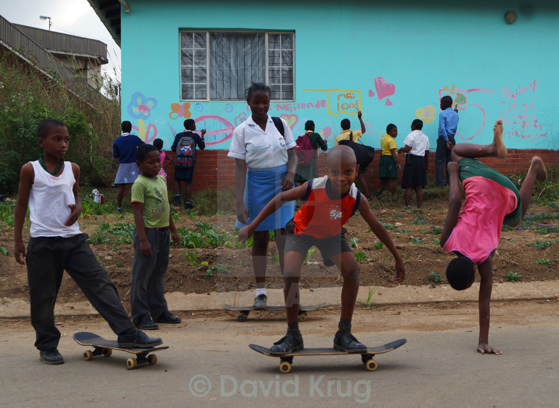 """""""Children playing, painting and skateboarding"""" stock image"""