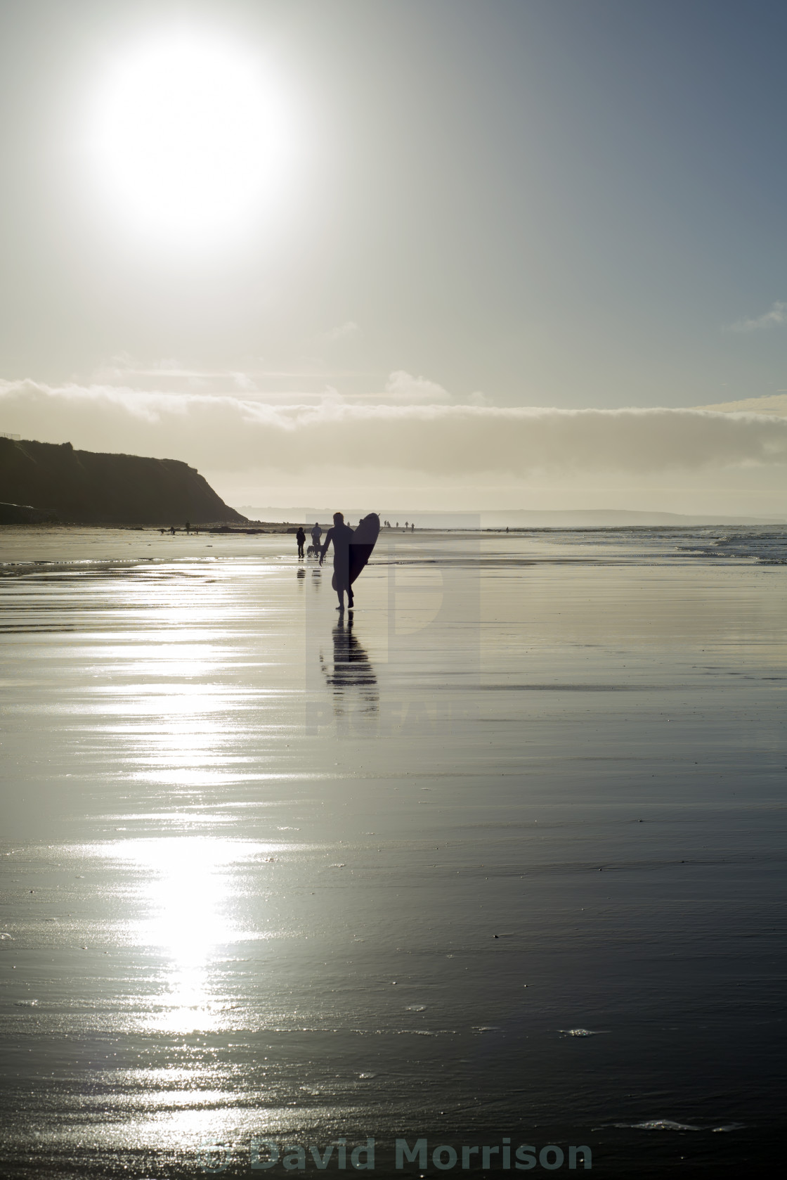 """surfer and people silhouette out on the beach"" stock image"