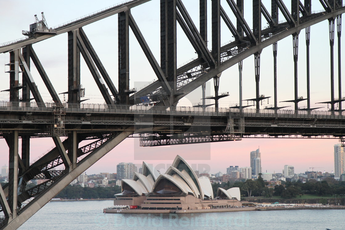 """Sydney Opera House framed by Sydney Harbour Bridge"" stock image"