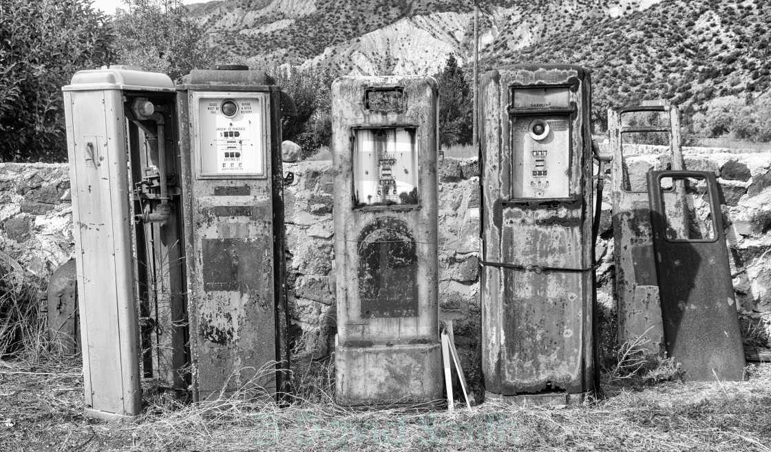 Black and White image of old rusting gas pumps found in an