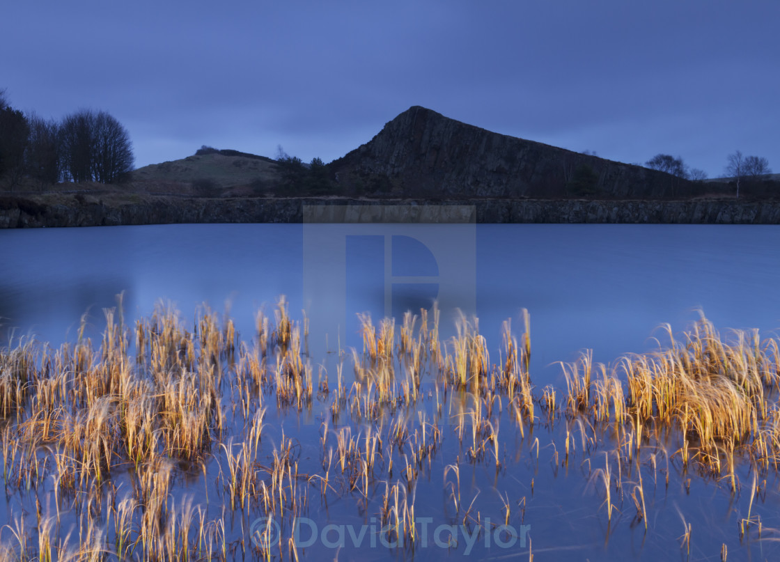 """Cawfields Crag by Torchlight"" stock image"