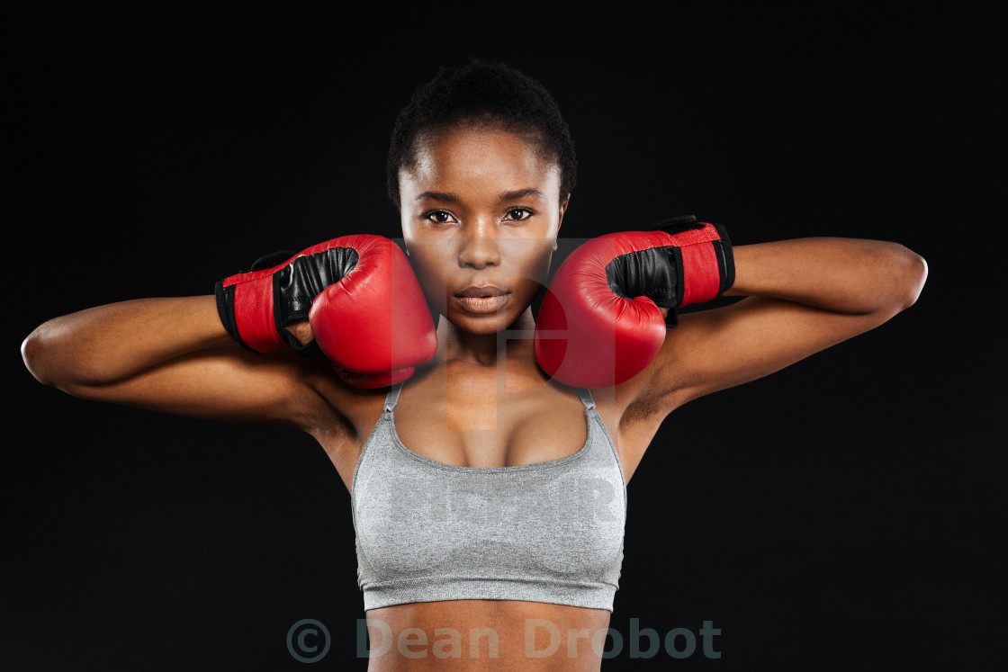 """""""Portrait of a beautiful fitness woman standing in boxing gloves"""" stock image"""