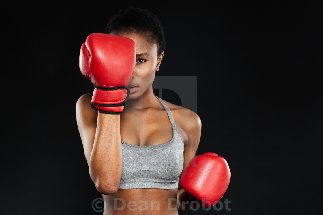 """""""Strong young fitness woman covered her face with boxing gloves"""" stock image"""