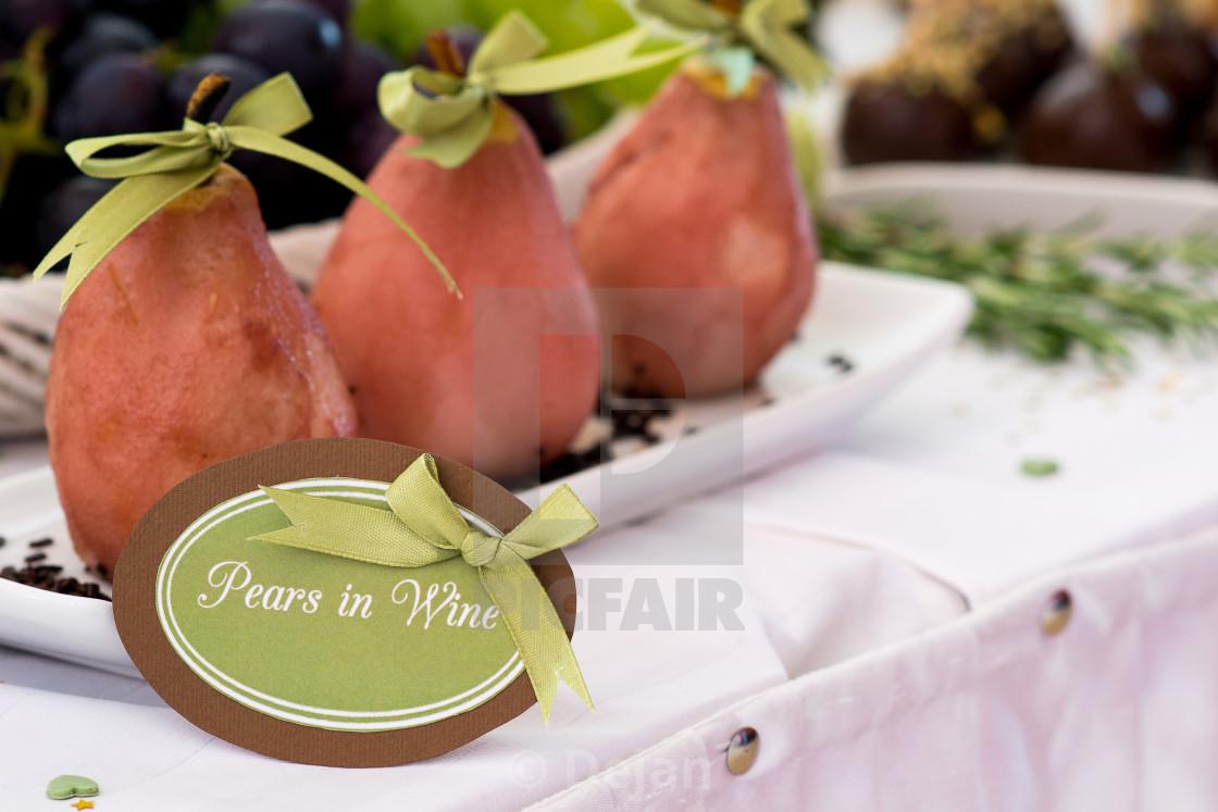 """Pears in wine, cookies"" stock image"