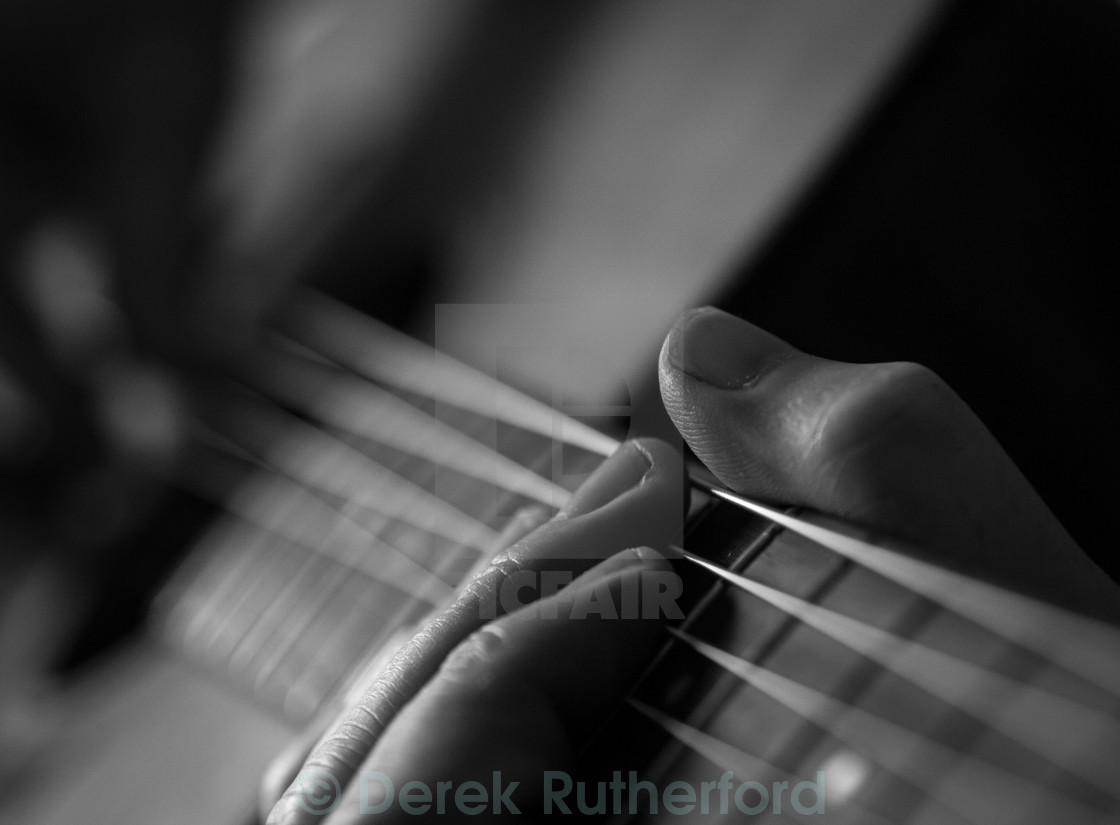 """Close up of Guitar Player"" stock image"