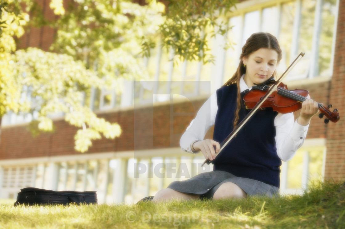 Teen Girl Playing Violin - License, download or print for