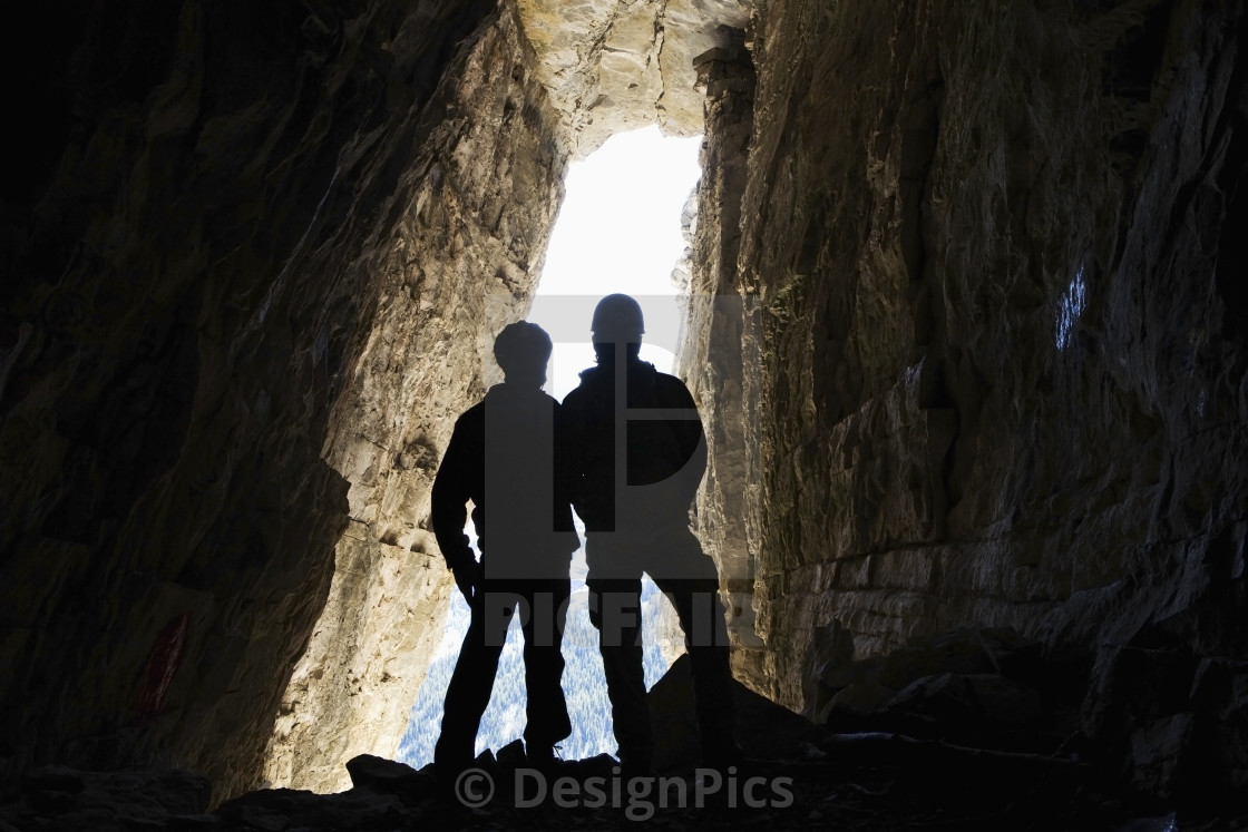 Silhouette Of Two Male Hikers In Cave With Entrance Glowing In The License Download Or Print For 30 32 Photos Picfair