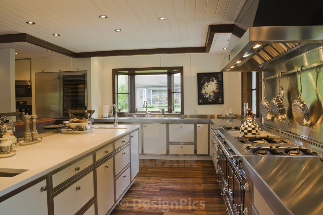 Country Style Kitchen With Island And Gas Stove Inside A New ...
