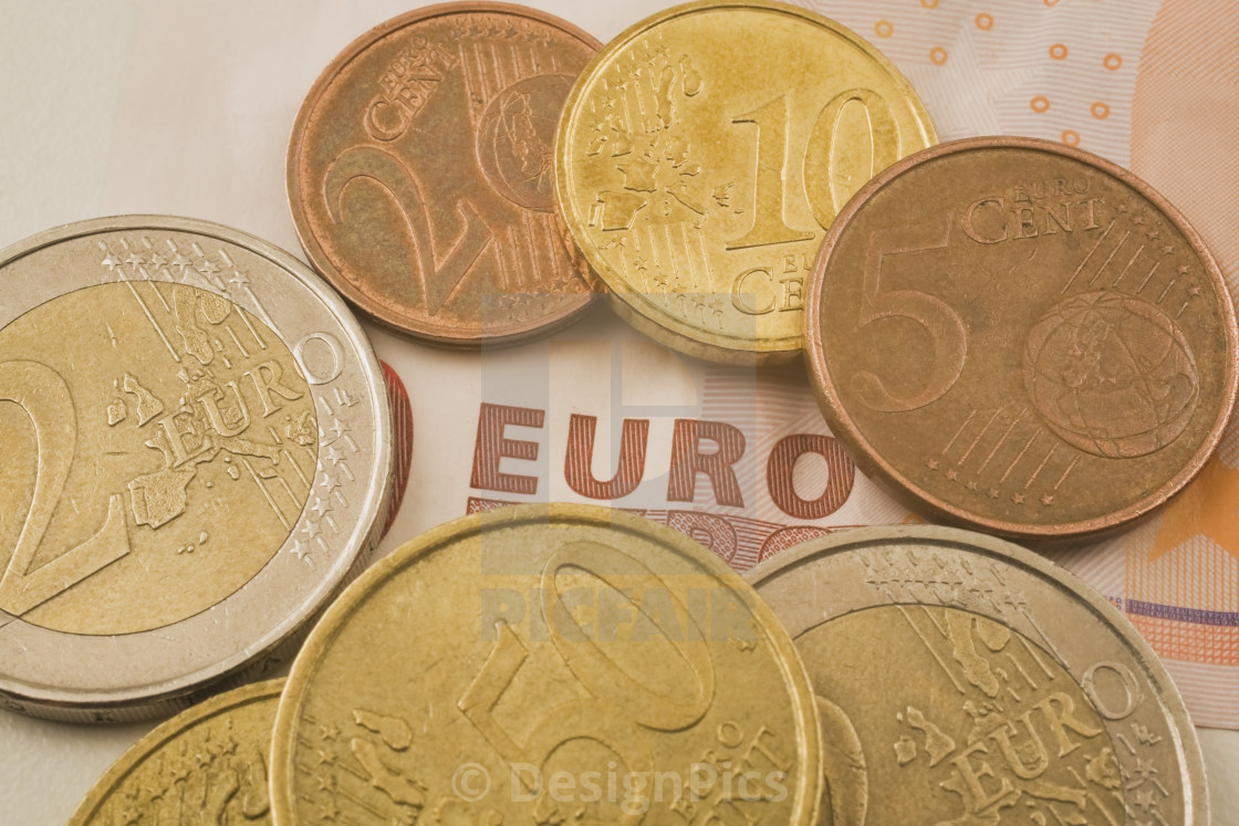 Euro Coins On Top Of A Euro Currency Bank Note