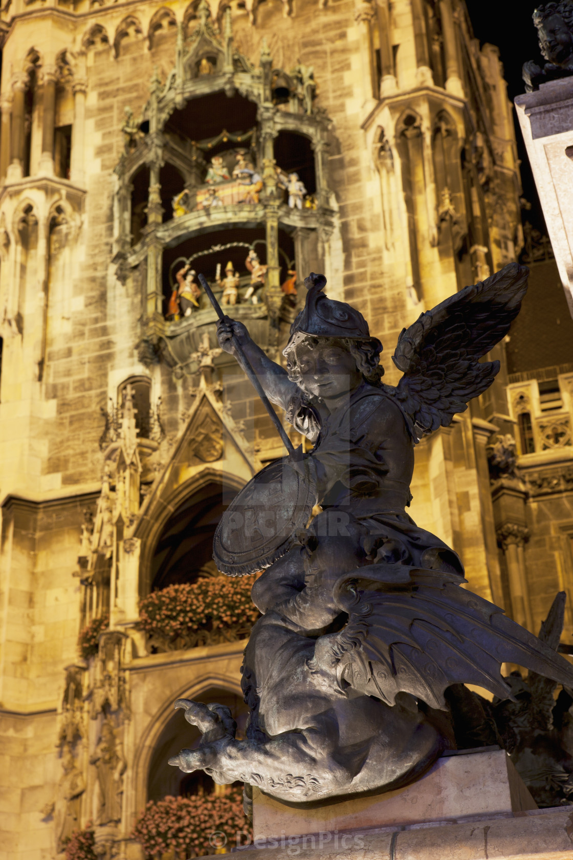 """Winged Statue With A Lit City Hall Tower And Glockenspiel In The Background..."" stock image"