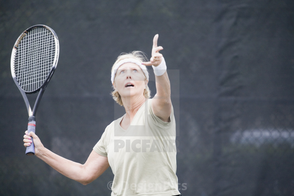 """Senior woman playing tennis"" stock image"