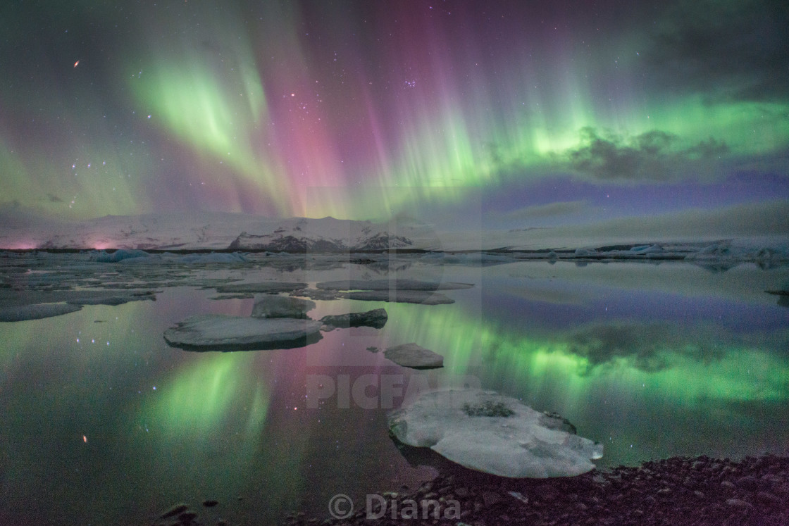 """The Northern lights viewed over Jokulsarlon glacier lake in Iceland"" stock image"