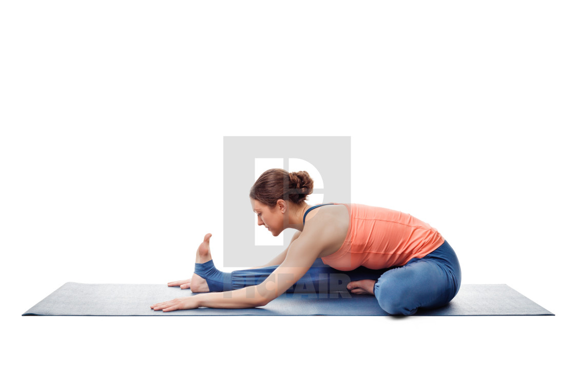 """Woman doing Ashtanga Vinyasa Yoga asana Janu sirsasana"" stock image"
