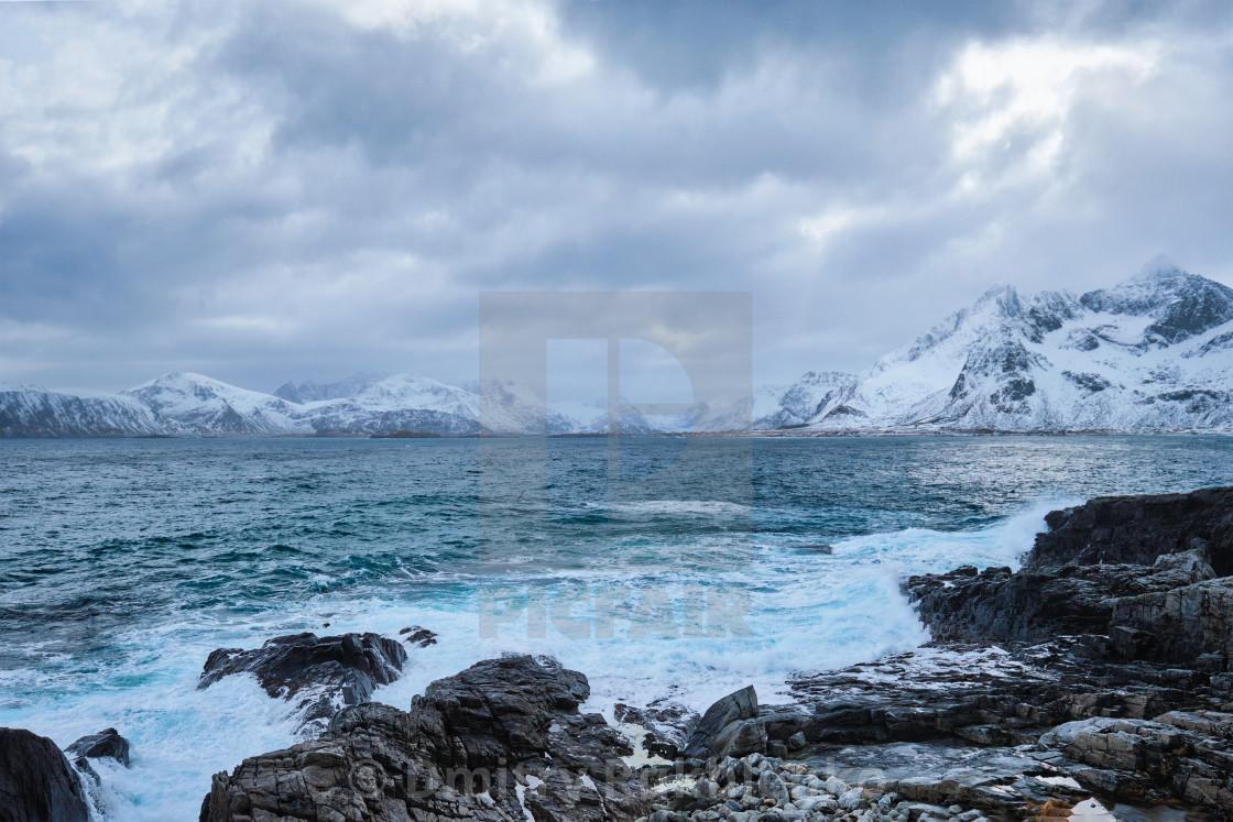 """Norwegian Sea waves on rocky coast of Lofoten islands, Norway"" stock image"