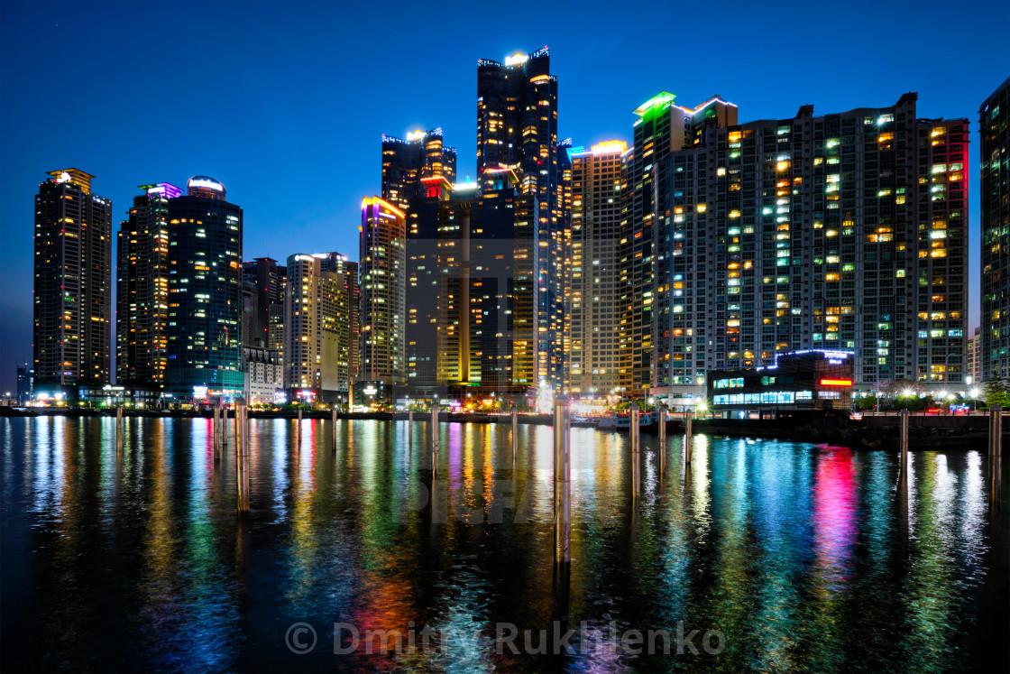 """Busan Marina city skyscrapers illluminated in night"" stock image"