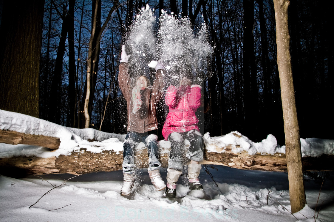 """Twin Sisters Playing in Fresh Snow"" stock image"