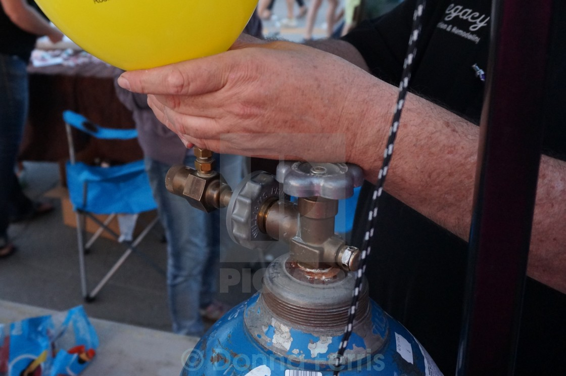 Helium tank filling balloons - License, download or print