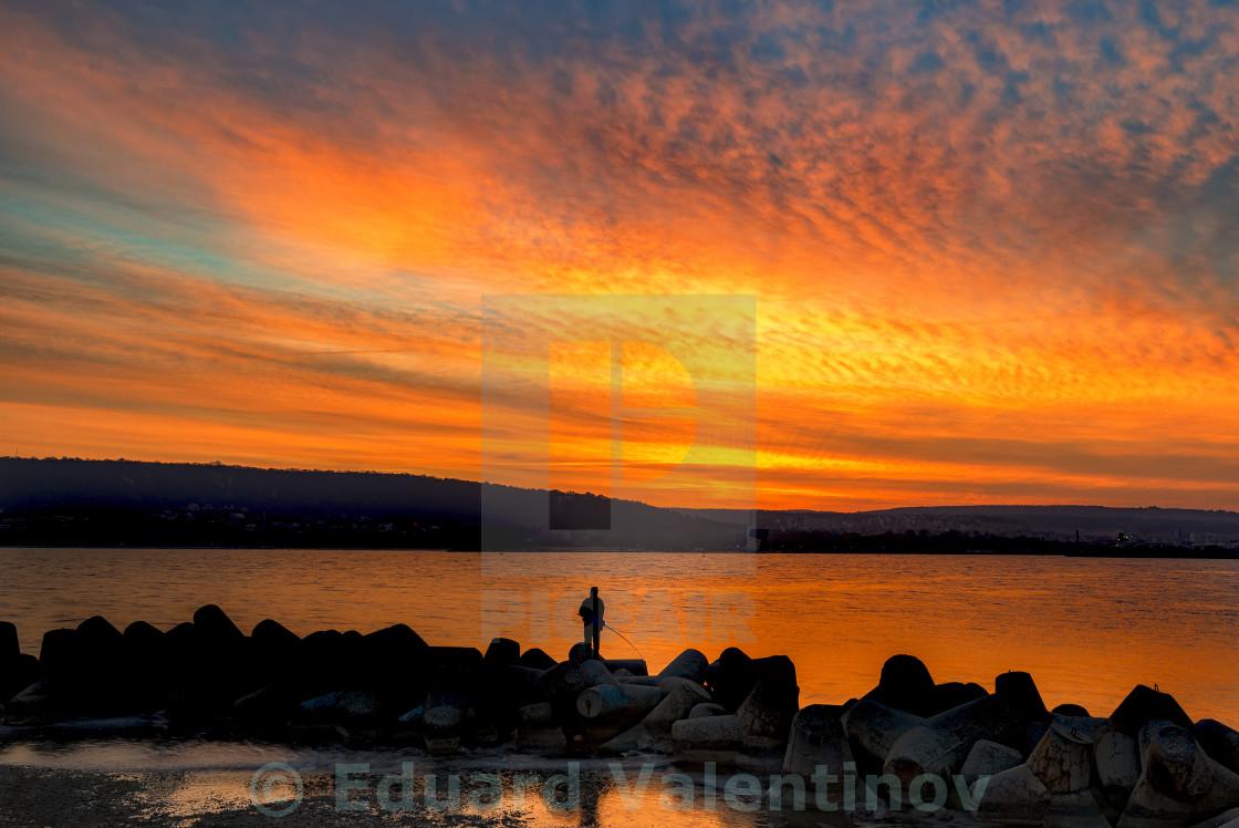 """""""Fishing at amazing sunset"""" stock image"""