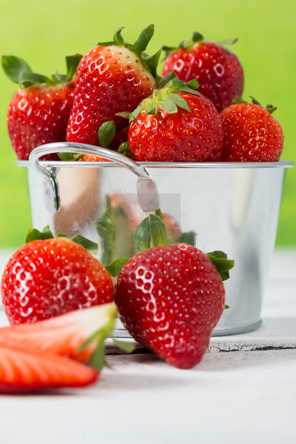 """Strawberries in a bucket"" stock image"