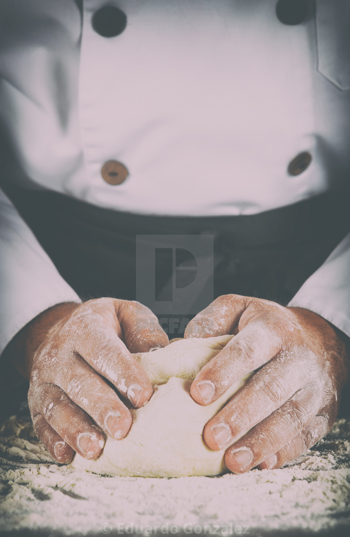 """Baker kneading dough with his hands"" stock image"