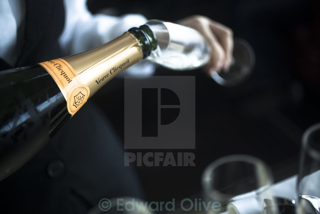 """Bottle of champagne waiter pouring glass Veuve Cliquot Ponsardin nightclub disco"" stock image"