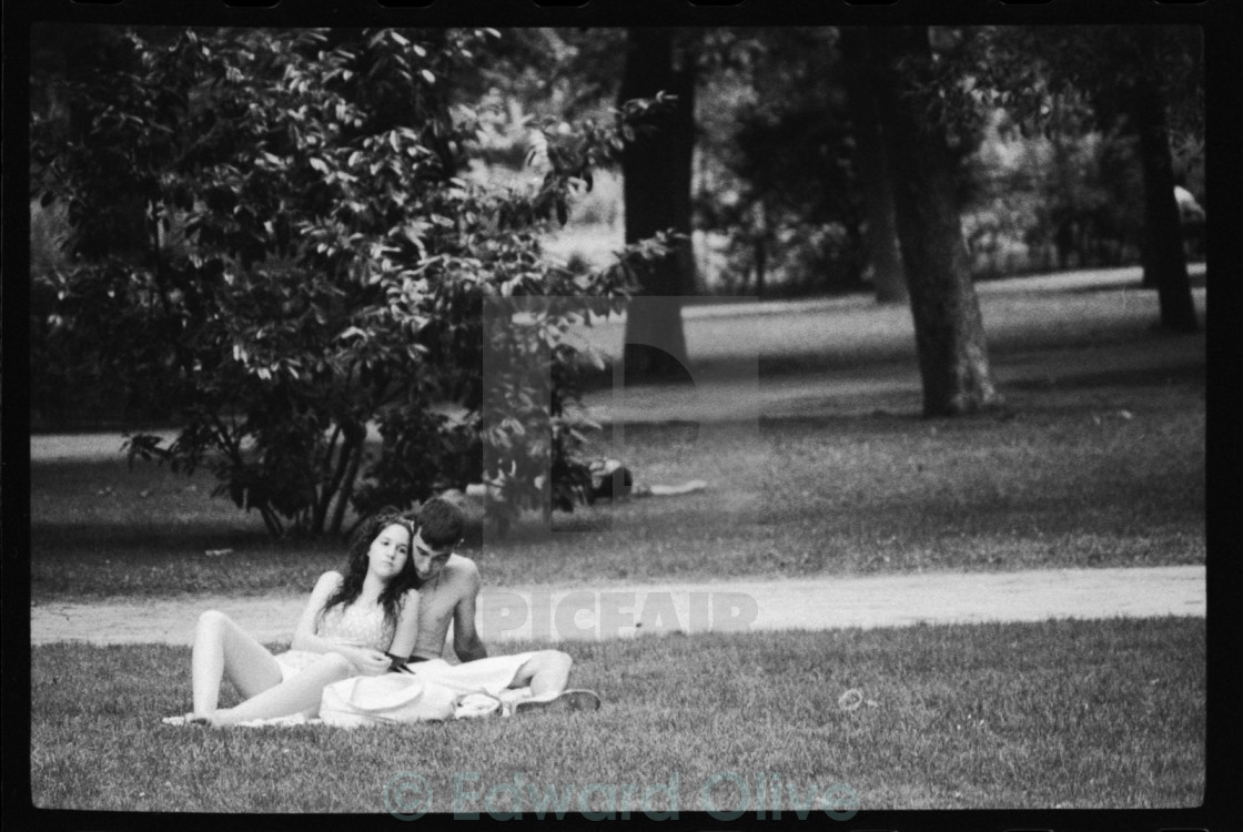 Photojournalism young couple lovers in park black and white stock image