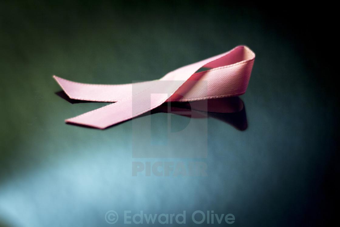 """Pink breast cancer ribbon bow symbol"" stock image"