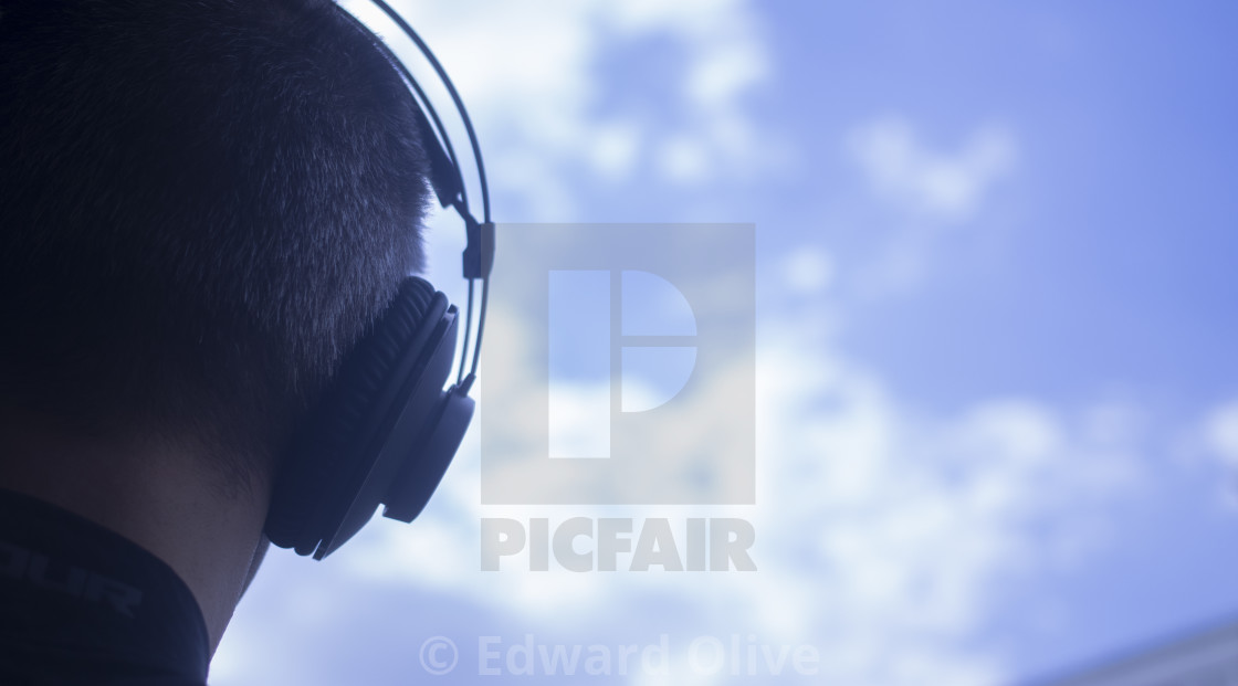 """DJ deejay producer wearing headphones"" stock image"