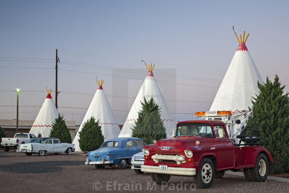 """Antique vehicles and teepees/wigwams, Wigwam Motel, Route 66, Holbrook, Arizona USA"" stock image"