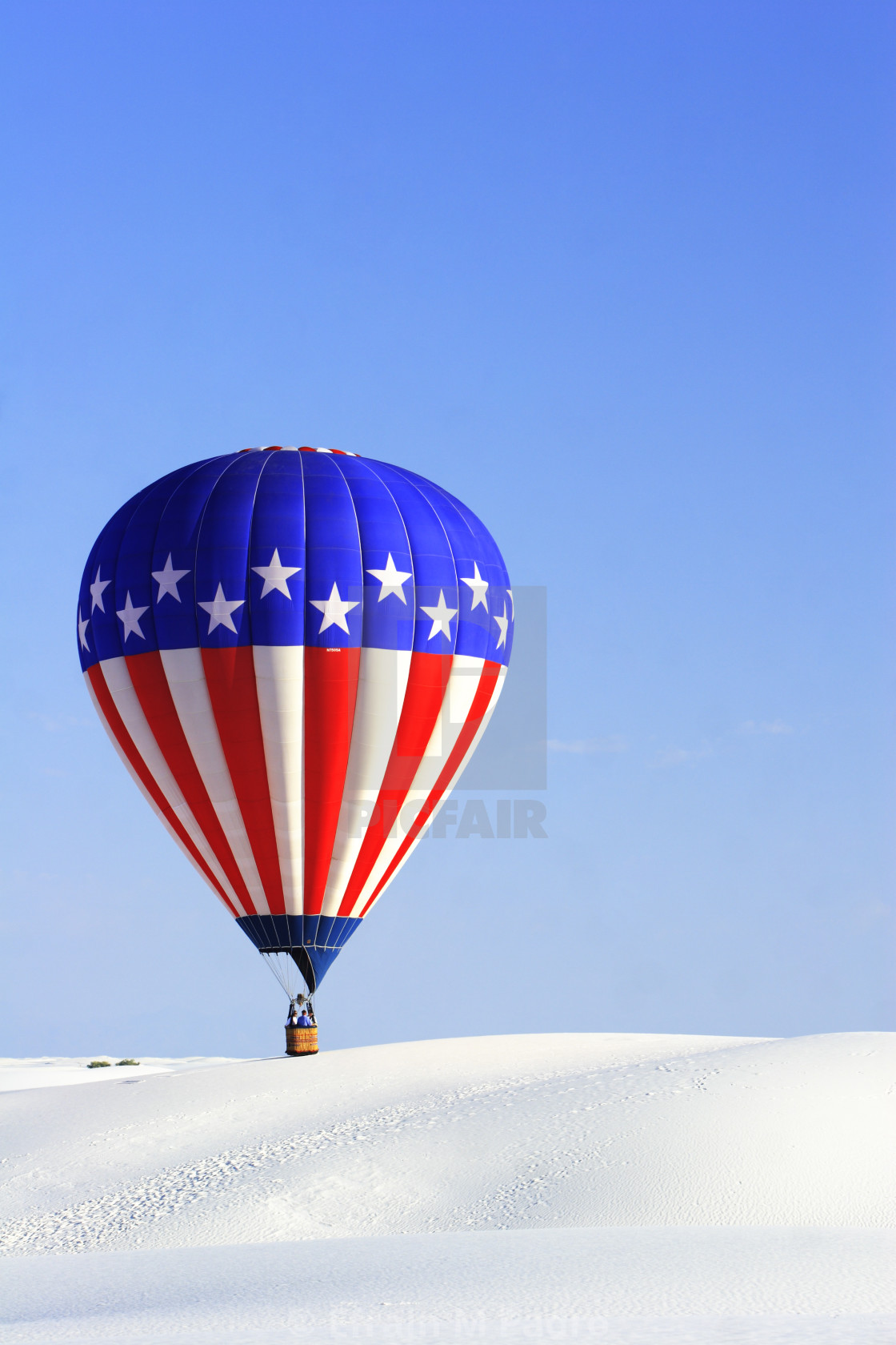 """Red, white and blue hot air balloon, White Sands National Monument Balloon Festival, near Alamogordo, New Mexico USA"" stock image"