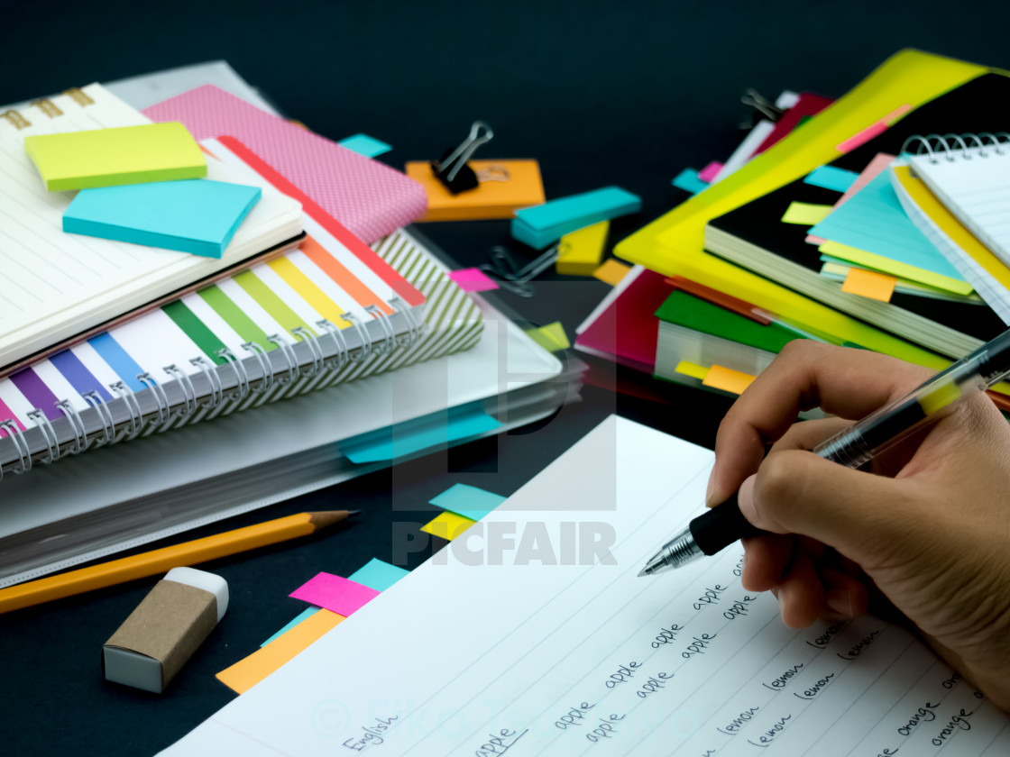 """""""Learning New Language Writing Words Many Times on the Notebook;"""" stock image"""