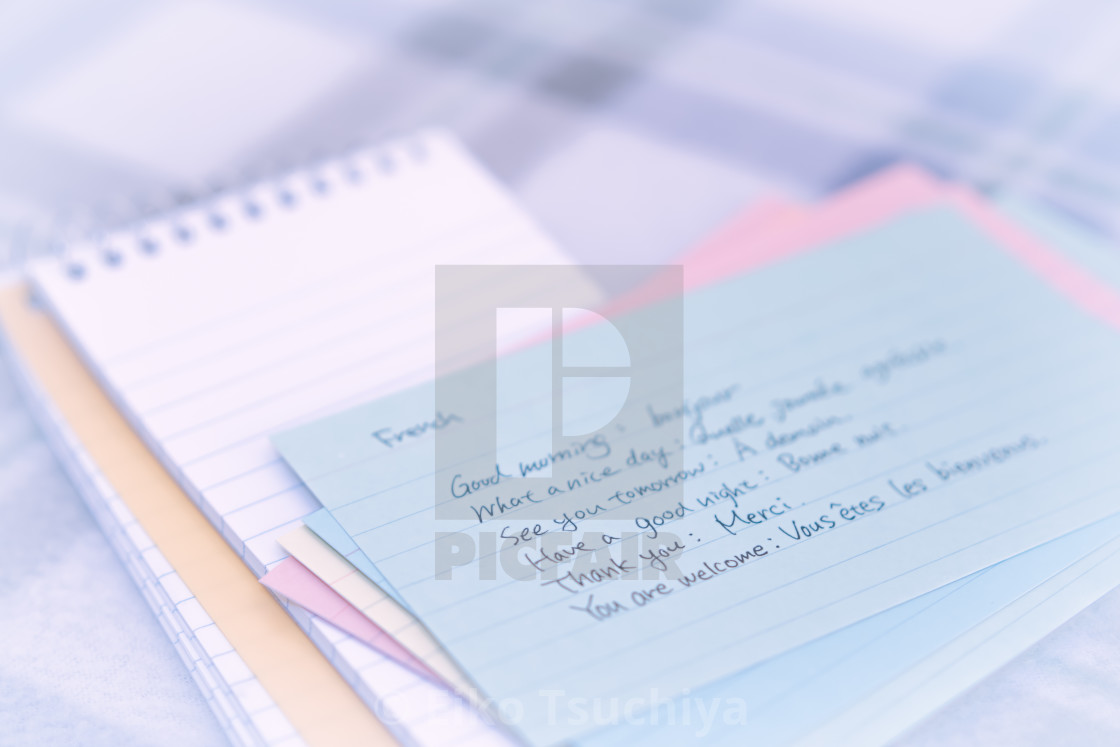 French learning new language writing greetings on the notebook french learning new language writing greetings on the notebook stock image m4hsunfo