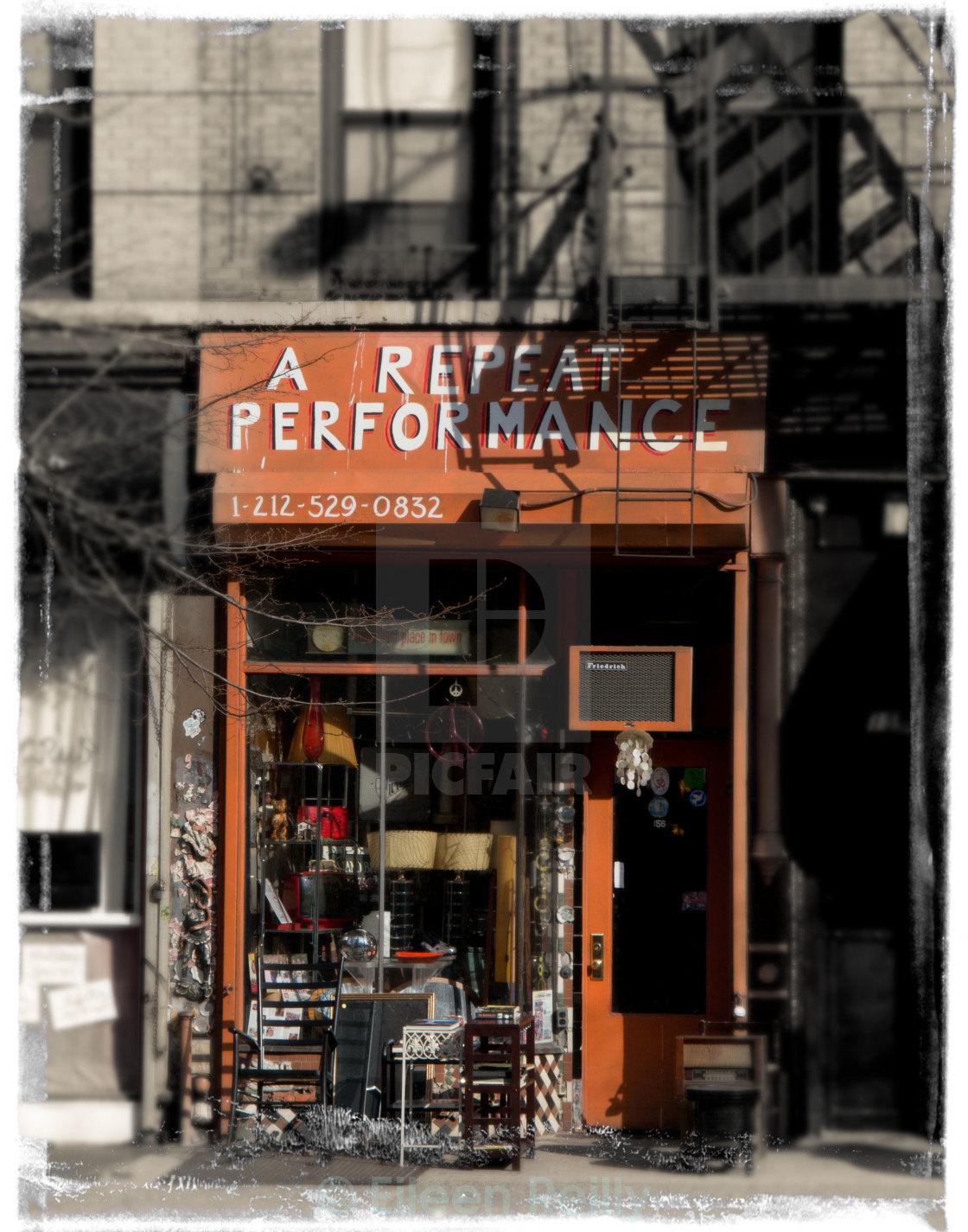 """Orange shopfront in New York City"" stock image"