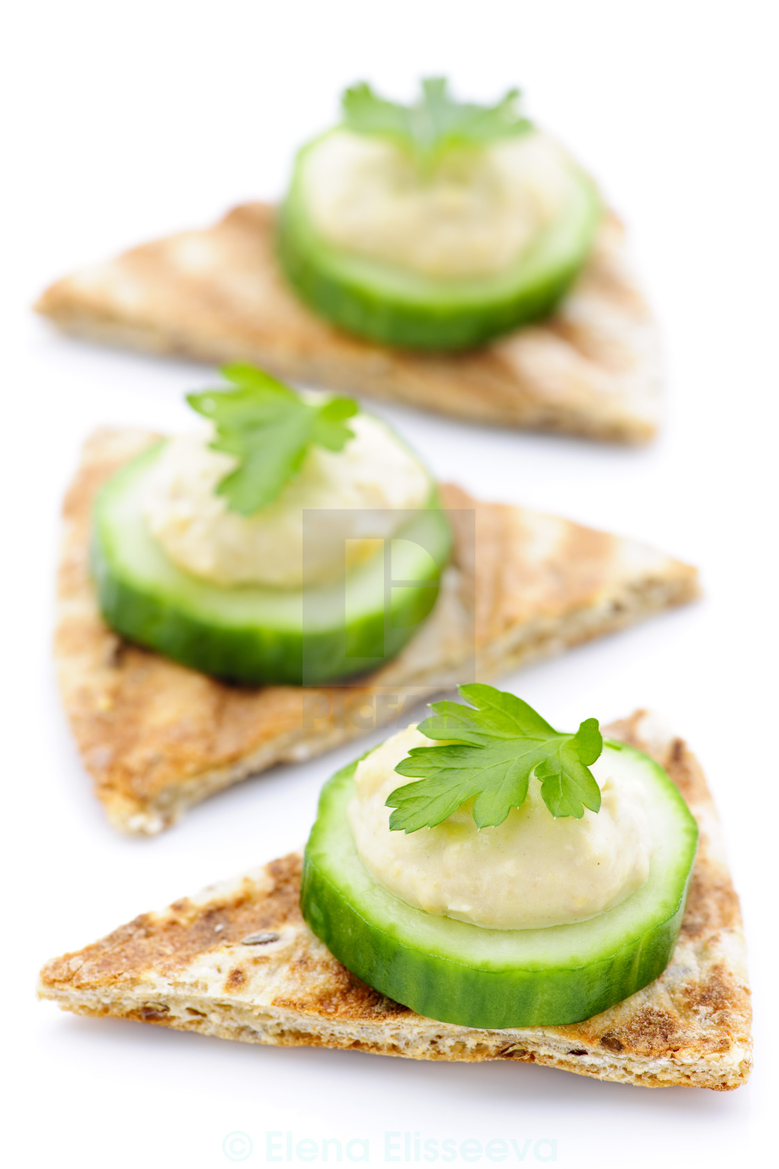 """Appetizer of pita with hummus and cucumber"" stock image"