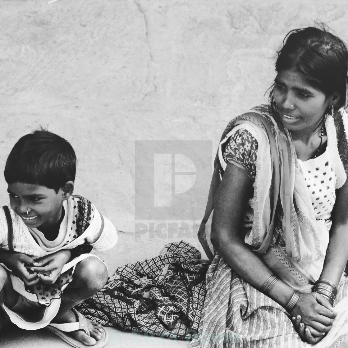 """""""Indian street life - mother and child smiling"""" stock image"""