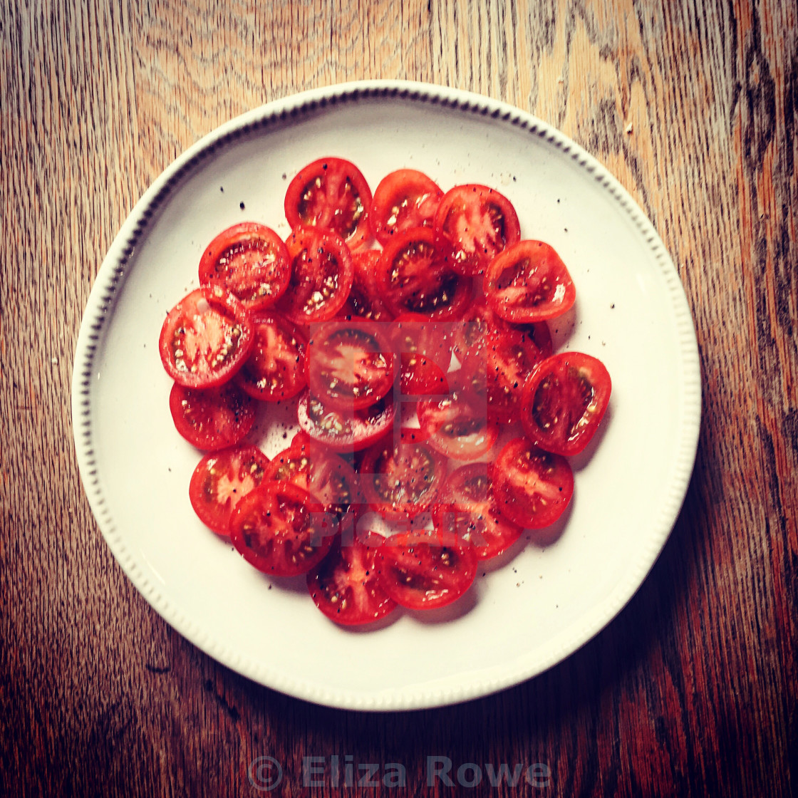 """""""tomatoes on a white plate"""" stock image"""