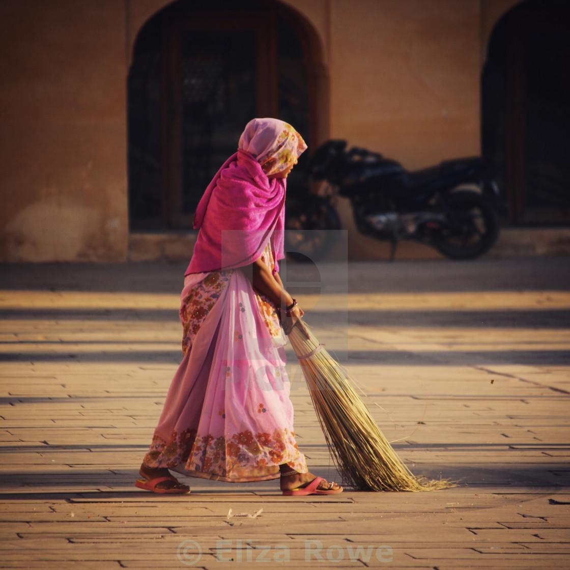 """Indian woman sweeping at Amber Palace"" stock image"