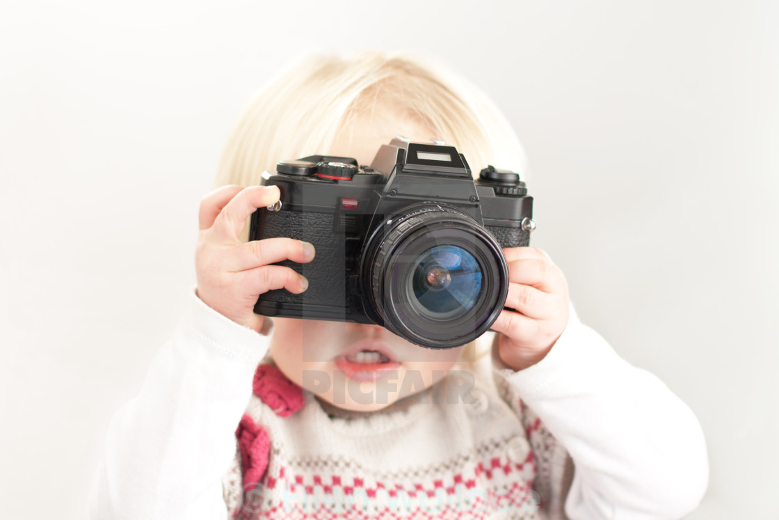 """Child holding a camera"" stock image"