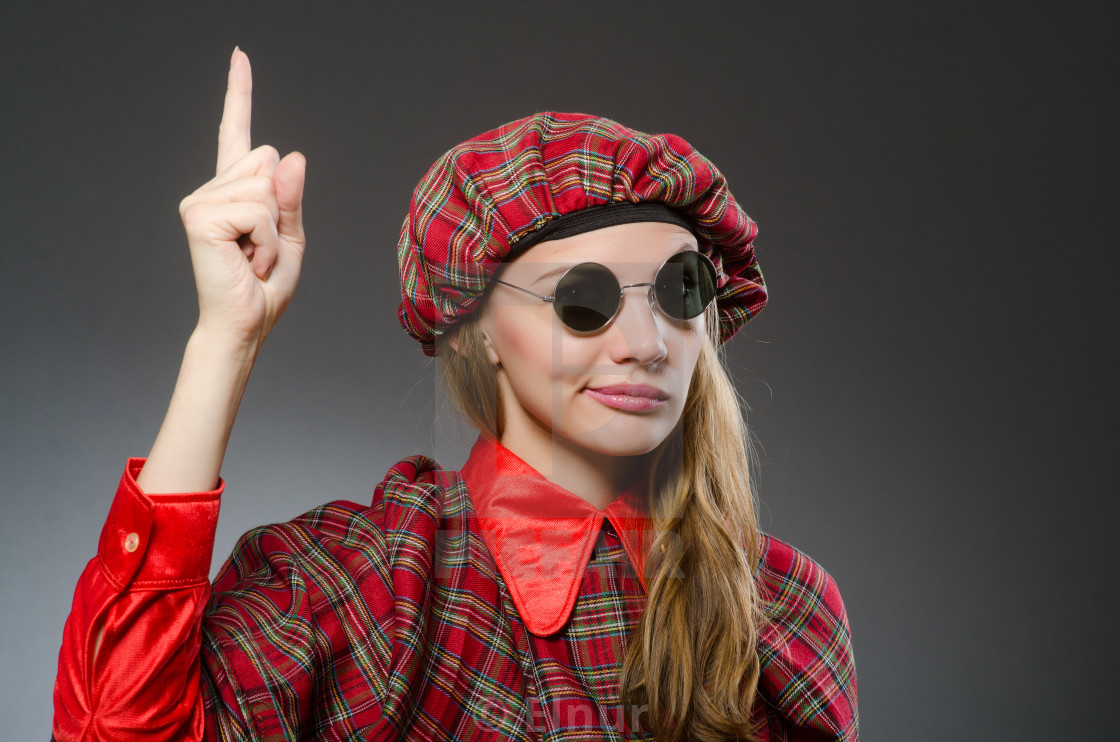 Woman wearing traditional scottish clothing - License