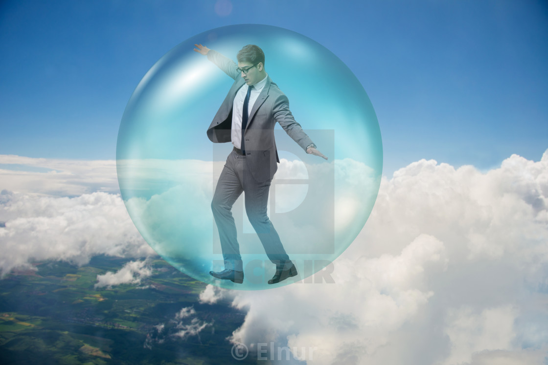"""Businessman flying inside the bubble"" stock image"
