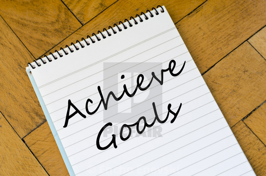 """Achieve goals concept on notebook"" stock image"