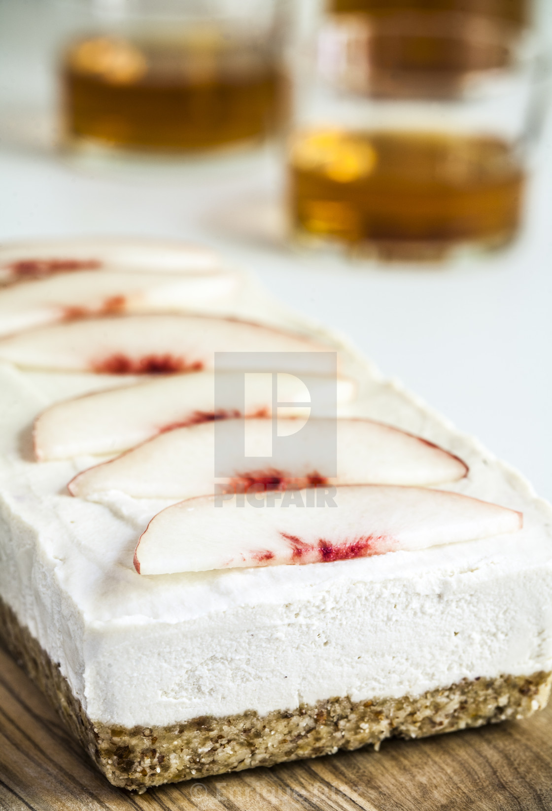 """Saturn peach cheesecake and wine"" stock image"